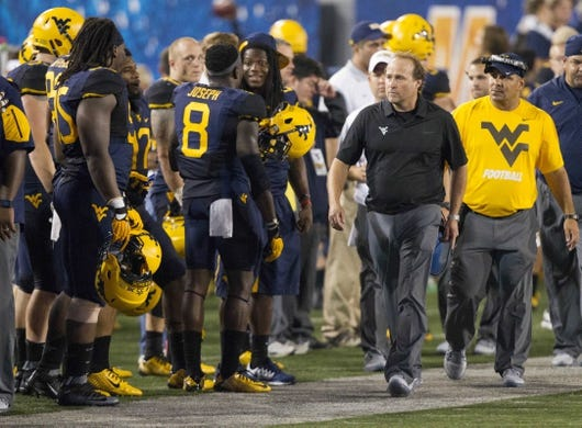 Sep 5, 2015; Morgantown, WV, USA; West Virginia Mountaineers head coach Dana Holgorsen talks to safety Karl Joseph on the sidelines during the fourth quarter against the Georgia Southern Eagles at Milan Puskar Stadium.  Mandatory Credit: Ben Queen-USA TODAY Sports