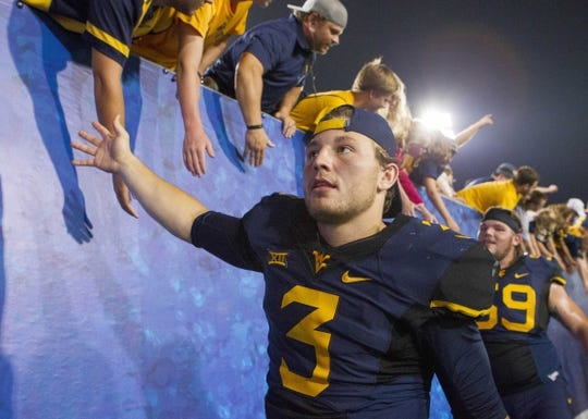 Sep 5, 2015; Morgantown, WV, USA; West Virginia Mountaineers quarterback Skyler Howard celebrates with fans after beating Georgia Southern 44-0. Mandatory Credit: Ben Queen-USA TODAY Sports