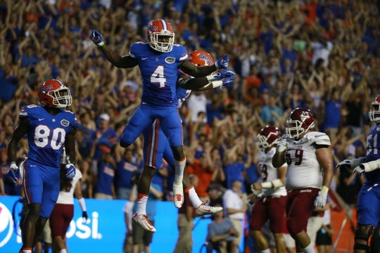 Sep 5, 2015; Gainesville, FL, USA Florida Gators wide receiver Brandon Powell (4) is congratulated by teammates as he scored a touchdown against the New Mexico State Aggies during the first quarter at Ben Hill Griffin Stadium. Mandatory Credit: Kim Klement-USA TODAY Sports