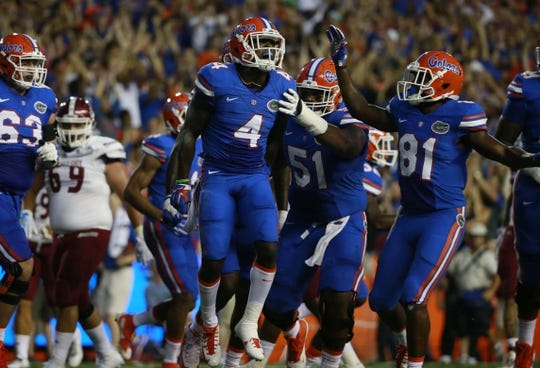 Sep 5, 2015; Gainesville, FL, USA Florida Gators wide receiver Brandon Powell (4) celebrates as he scores a touchdown against the New Mexico State Aggies during the first quarter at Ben Hill Griffin Stadium. Mandatory Credit: Kim Klement-USA TODAY Sports