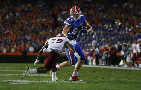 Sep 5, 2015; Gainesville, FL, USA Florida Gators tight end Jake McGee (83) stiff arms New Mexico State Aggies defensive back Lewis Hill (29) during the first quarter at Ben Hill Griffin Stadium. Mandatory Credit: Kim Klement-USA TODAY Sports