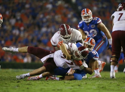 Sep 5, 2015; Gainesville, FL, USA; Florida Gators defensive lineman Justus Reed (97) sacks New Mexico State Aggies quarterback Tyler Rogers (17) during the second half at Ben Hill Griffin Stadium. Mandatory Credit: Kim Klement-USA TODAY Sports