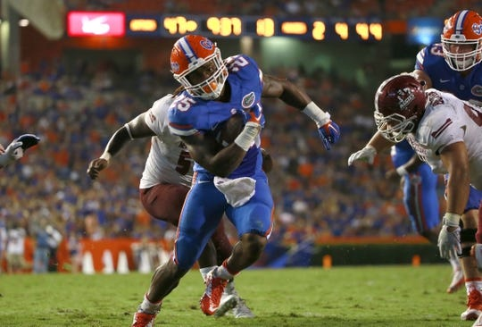 Sep 5, 2015; Gainesville, FL, USA; Florida Gators running back Jordan Scarlett (25) runs the ball in for a touchdown against the New Mexico State Aggies during the second half at Ben Hill Griffin Stadium. Mandatory Credit: Kim Klement-USA TODAY Sports