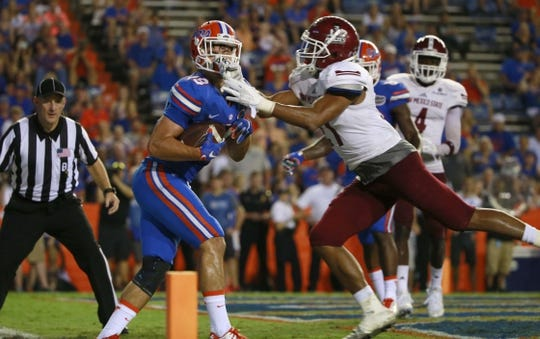 Sep 5, 2015; Gainesville, FL, USA; Florida Gators wide receiver C.J. Worton (18) catches the ball for a touchdown against the New Mexico State Aggies during the second half at Ben Hill Griffin Stadium. Mandatory Credit: Kim Klement-USA TODAY Sports