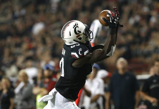 Sep 5, 2015; Cincinnati, OH, USA; Cincinnati Bearcats wide receiver Alex Chisum (80) makes a catch for a touchdown in the second half against the Alabama A&M Bulldogs in the second half at Nippert Stadium. The Bearcats won 52-10. Mandatory Credit: Aaron Doster-USA TODAY Sports