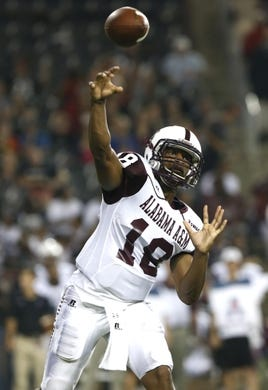 Sep 5, 2015; Cincinnati, OH, USA; Alabama A&M Bulldogs quarterback De'Angelo Ballard (18) throws a pass in the second half against the Cincinnati Bearcats at Nippert Stadium. The Bearcats won 52-10. Mandatory Credit: Aaron Doster-USA TODAY Sports