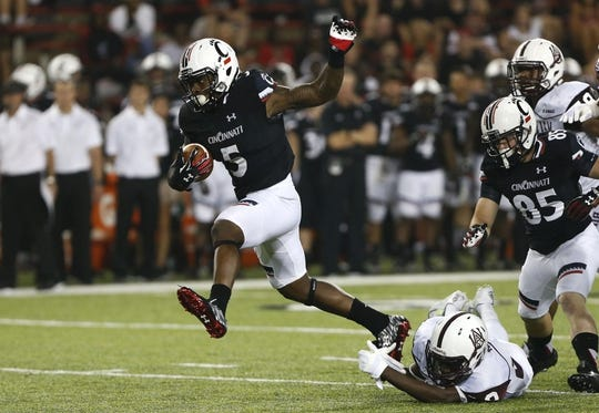 Sep 5, 2015; Cincinnati, OH, USA; Cincinnati Bearcats running back Mike Boone (5) carries the ball in the second half against the Alabama A&M Bulldogs at Nippert Stadium. The Bearcats won 52-10. Mandatory Credit: Aaron Doster-USA TODAY Sports