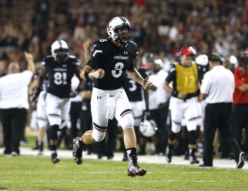Sep 5, 2015; Cincinnati, OH, USA; Cincinnati Bearcats quarterback Hayden Moore (8) reacts to throwing a touchdown to wide receiver Alex Chisum (not pictured) in the second half  against the Alabama A&M Bulldogs at Nippert Stadium. The Bearcats won 52-10. Mandatory Credit: Aaron Doster-USA TODAY Sports