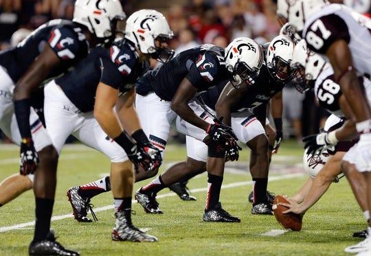 Sep 5, 2015; Cincinnati, OH, USA; The Cincinnati Bearcats line up on defense against the Alabama A&M Bulldogs at Nippert Stadium. The Bearcats won 52-10. Mandatory Credit: Aaron Doster-USA TODAY Sports