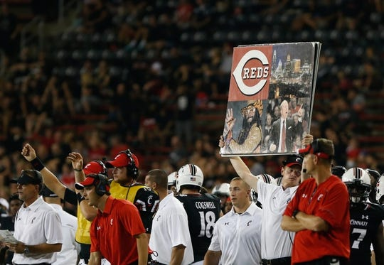 Sep 5, 2015; Cincinnati, OH, USA; The Cincinnati Bearcats hold play cards on the sidelines against the Alabama A&M Bulldogs at Nippert Stadium. The Bearcats won 52-10. Mandatory Credit: Aaron Doster-USA TODAY Sports