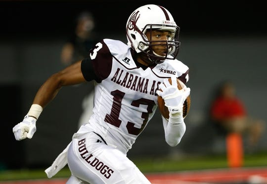 Sep 5, 2015; Cincinnati, OH, USA; Alabama A&M Bulldogs wide receiver DeVon Johnson (13) against the Cincinnati Bearcats at Nippert Stadium. The Bearcats won 52-10. Mandatory Credit: Aaron Doster-USA TODAY Sports