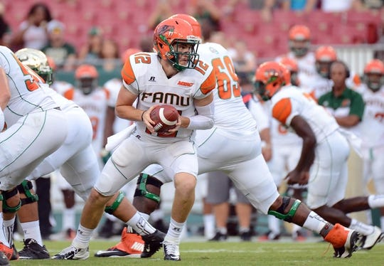 Sep 5, 2015; Tampa, FL, USA; Florida A & M Rattlers  quarterback Carson Royal (12) prepares to hand the ball off in the first half against the South Florida Bulls at Raymond James Stadium. Mandatory Credit: Jonathan Dyer-USA TODAY Sports