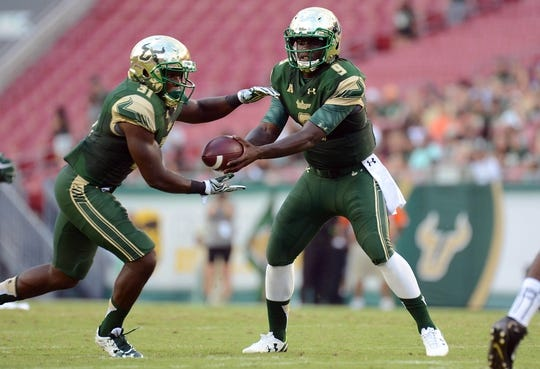 Sep 5, 2015; Tampa, FL, USA; South Florida Bulls quarterback Quentin Flowers (9) hands the ball off during the first half against the Florida A & M Rattlers at Raymond James Stadium. Mandatory Credit: Jonathan Dyer-USA TODAY Sports