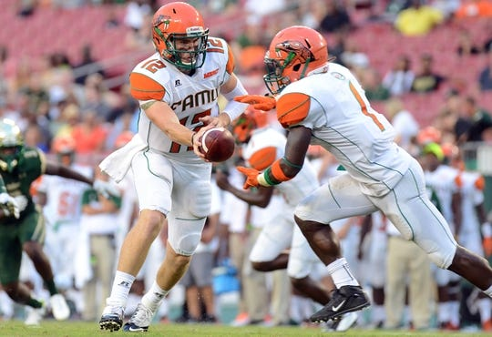 Sep 5, 2015; Tampa, FL, USA; Florida A & M Rattlers  quarterback Carson Royal (12) hands the ball off during the first half against the South Florida Bulls at Raymond James Stadium. Mandatory Credit: Jonathan Dyer-USA TODAY Sports