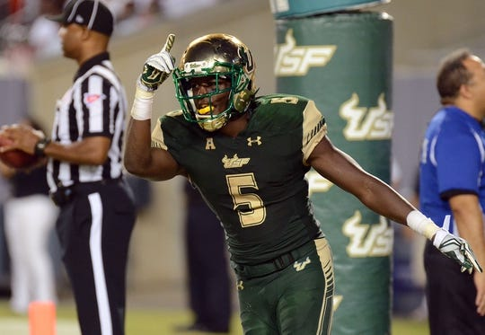 Sep 5, 2015; Tampa, FL, USA; South Florida Bulls running back Marlon Mack (5) scores a touchdown in the second half against the Florida A & M Rattlers  at Raymond James Stadium. Mandatory Credit: Jonathan Dyer-USA TODAY Sports