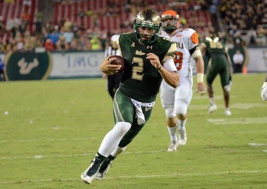 Sep 5, 2015; Tampa, FL, USA; South Florida Bulls quarterback Steven bench (2) scores a touchdown in the second half against the Florida A & M Rattlers at Raymond James Stadium. Mandatory Credit: Jonathan Dyer-USA TODAY Sports