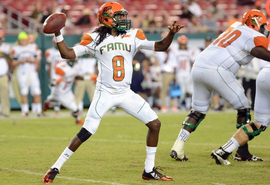 Sep 5, 2015; Tampa, FL, USA; Florida A & M Rattlers  quarterback Kenneth Coleman (8) throws the ball in the second half against South Florida Bulls  the  at Raymond James Stadium. Mandatory Credit: Jonathan Dyer-USA TODAY Sports