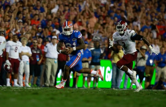 Sep 5, 2015; Gainesville, FL, USA Florida Gators running back Kelvin Taylor (21) runs with the ball against the New Mexico State Aggies during the first quarter at Ben Hill Griffin Stadium. Mandatory Credit: Kim Klement-USA TODAY Sports