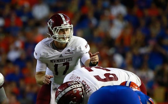 Sep 5, 2015; Gainesville, FL, USA; New Mexico State Aggies quarterback Tyler Rogers (17) points against the Florida Gators  during the second quarter at Ben Hill Griffin Stadium. Mandatory Credit: Kim Klement-USA TODAY Sports