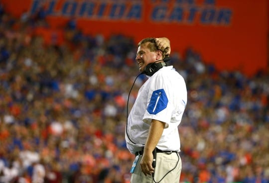 Sep 5, 2015; Gainesville, FL, USA; Florida Gators head coach Jim McElwain scratches his head against the New Mexico State Aggies during the second quarter at Ben Hill Griffin Stadium. Mandatory Credit: Kim Klement-USA TODAY Sports