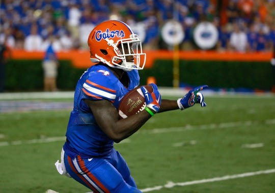 Sep 5, 2015; Gainesville, FL, USA; Florida Gators wide receiver Brandon Powell (4) runs with the ball against the New Mexico State Aggies during the second quarter at Ben Hill Griffin Stadium. Mandatory Credit: Kim Klement-USA TODAY Sports