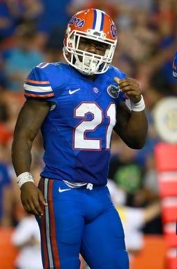 Sep 5, 2015; Gainesville, FL, USA; Florida Gators running back Kelvin Taylor (21) during the second quarter at Ben Hill Griffin Stadium. Mandatory Credit: Kim Klement-USA TODAY Sports
