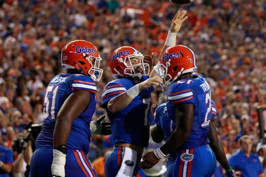 Sep 5, 2015; Gainesville, FL, USA; Florida Gators quarterback Will Grier (7) is congratulated by running back Kelvin Taylor (21) as he scored a touchdown against the New Mexico State Aggies during the second quarter at Ben Hill Griffin Stadium. Mandatory Credit: Kim Klement-USA TODAY Sports