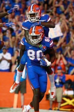 Sep 5, 2015; Gainesville, FL, USA; Florida Gators tight end C'yontai Lewis (80) is congratulated by wide receiver Brandon Powell (4) as he ran the ball in for a touchdown against the New Mexico State Aggies during the second quarter at Ben Hill Griffin Stadium. Mandatory Credit: Kim Klement-USA TODAY Sports