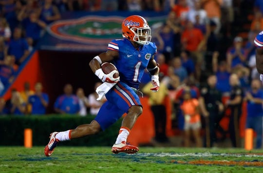 Sep 5, 2015; Gainesville, FL, USA; Florida Gators defensive back Vernon Hargreaves III (1) runs with the ball after an interception against the New Mexico State Aggies  during the second half at Ben Hill Griffin Stadium. Mandatory Credit: Kim Klement-USA TODAY Sports