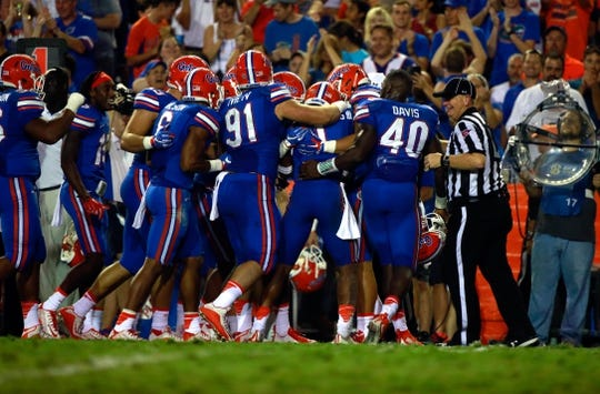 Sep 5, 2015; Gainesville, FL, USA; Florida Gators defensive back Vernon Hargreaves III (1) is congratulated after he intercepted the ball against the New Mexico State Aggies during the second half at Ben Hill Griffin Stadium. Mandatory Credit: Kim Klement-USA TODAY Sports