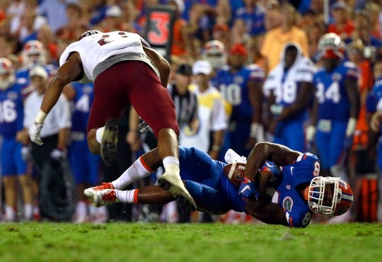 Sep 5, 2015; Gainesville, FL, USA; Florida Gators wide receiver Alvin Bailey (89) catches the ball against the New Mexico State Aggies during the second half at Ben Hill Griffin Stadium. Mandatory Credit: Kim Klement-USA TODAY Sports