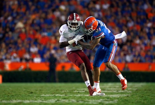 Sep 5, 2015; Gainesville, FL, USA; Florida Gators defensive back Jalen Tabor (31) tackles New Mexico State Aggies wide receiver Gregory Hogan (2) during the second half at Ben Hill Griffin Stadium. Mandatory Credit: Kim Klement-USA TODAY Sports
