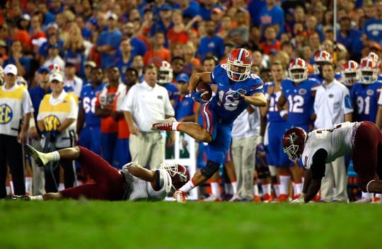 Sep 5, 2015; Gainesville, FL, USA; Florida Gators wide receiver C.J. Worton (18) runs past New Mexico State Aggies during the second half at Ben Hill Griffin Stadium. Mandatory Credit: Kim Klement-USA TODAY Sports