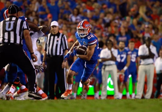 Sep 5, 2015; Gainesville, FL, USA; Florida Gators quarterback Harry Gornto (22) runs with the ball against the New Mexico State Aggies  during the second half at Ben Hill Griffin Stadium. Mandatory Credit: Kim Klement-USA TODAY Sports