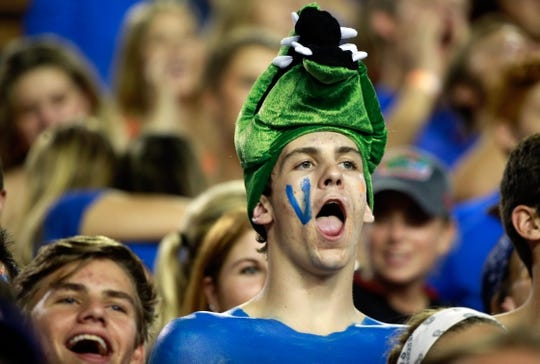 Sep 5, 2015; Gainesville, FL, USA; Florida Gators fan cheers against the New Mexico State Aggies during the second half at Ben Hill Griffin Stadium. Mandatory Credit: Kim Klement-USA TODAY Sports