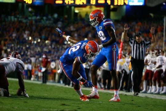 Sep 5, 2015; Gainesville, FL, USA; Florida Gators wide receiver Josh Grady (12) reacts as he scored a touchdown against the New Mexico State Aggies during the second half at Ben Hill Griffin Stadium. Mandatory Credit: Kim Klement-USA TODAY Sports