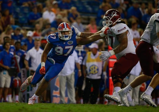 Sep 5, 2015; Gainesville, FL, USA; Florida Gators defensive lineman Justus Reed (97) rushes against the New Mexico State Aggies during the second half at Ben Hill Griffin Stadium. Mandatory Credit: Kim Klement-USA TODAY Sports