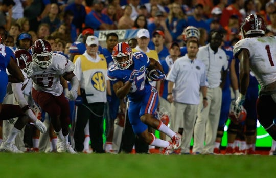 Sep 5, 2015; Gainesville, FL, USA; Florida Gators running back Mark Herndon (37) runs with the ball against the New Mexico State Aggies during the second half at Ben Hill Griffin Stadium. Mandatory Credit: Kim Klement-USA TODAY Sports