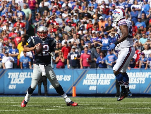 Sep 20, 2015; Orchard Park, NY, USA; Buffalo Bills defensive end Mario Williams (94) watches as New England Patriots quarterback Tom Brady (12) looks to make a pass during the first half at Ralph Wilson Stadium. Mandatory Credit: Timothy T. Ludwig-USA TODAY Sports