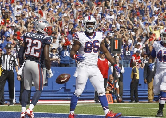 Sep 20, 2015; Orchard Park, NY, USA; Buffalo Bills tight end Charles Clay (85) celebrates his first half touchdown against the New England Patriots at Ralph Wilson Stadium. Mandatory Credit: Timothy T. Ludwig-USA TODAY Sports