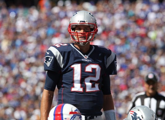 Sep 20, 2015; Orchard Park, NY, USA; New England Patriots quarterback Tom Brady (12) during the first half against the Buffalo Bills at Ralph Wilson Stadium. Mandatory Credit: Timothy T. Ludwig-USA TODAY Sports