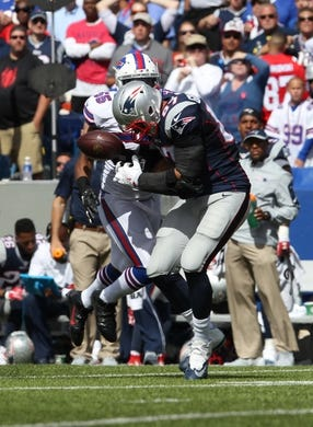 Sep 20, 2015; Orchard Park, NY, USA; Buffalo Bills defensive end Jerry Hughes (55) breaks up a pass to New England Patriots tight end Rob Gronkowski (87) during the first half at Ralph Wilson Stadium. Mandatory Credit: Timothy T. Ludwig-USA TODAY Sports