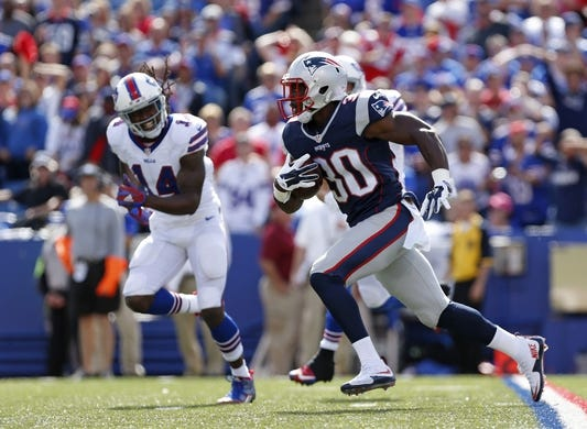 Sep 20, 2015; Orchard Park, NY, USA; New England Patriots cornerback Duron Harmon (30) runs with the ball after he intercepts a pass as Buffalo Bills wide receiver Sammy Watkins (14) pursues during the first half at Ralph Wilson Stadium. Mandatory Credit: Kevin Hoffman-USA TODAY Sports