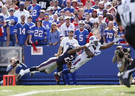 Sep 20, 2015; Orchard Park, NY, USA; New England Patriots defensive back Bradley Fletcher (24) is called for interference as Buffalo Bills wide receiver Percy Harvin (18) reaches for the ball during the first half at Ralph Wilson Stadium. Mandatory Credit: Kevin Hoffman-USA TODAY Sports