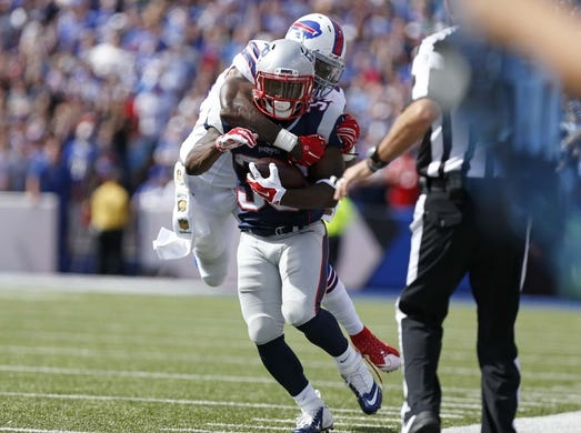 Sep 20, 2015; Orchard Park, NY, USA; Buffalo Bills outside linebacker Nigel Bradham (53) tackles New England Patriots running back Dion Lewis (33) after he catches a pass during the first half at Ralph Wilson Stadium. Mandatory Credit: Kevin Hoffman-USA TODAY Sports