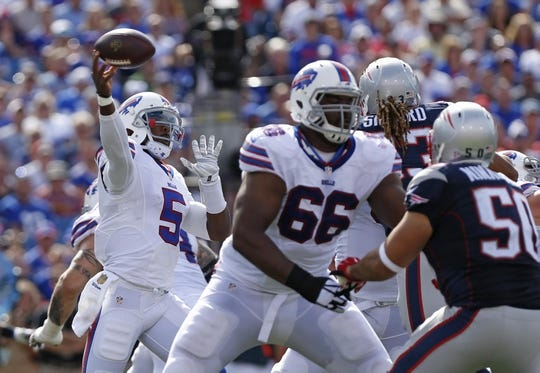 Sep 20, 2015; Orchard Park, NY, USA; Buffalo Bills quarterback Tyrod Taylor (5) throws a pass during the first half against the New England Patriots at Ralph Wilson Stadium. Mandatory Credit: Kevin Hoffman-USA TODAY Sports