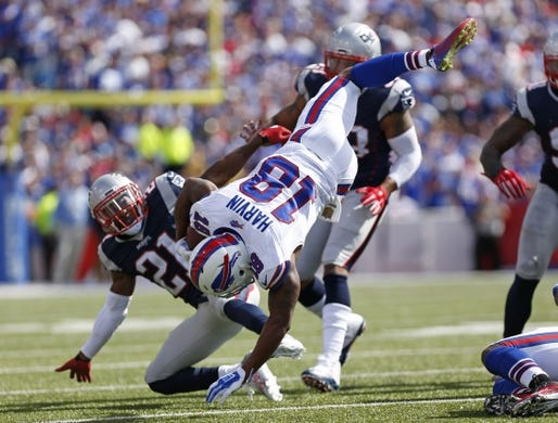 Sep 20, 2015; Orchard Park, NY, USA; Buffalo Bills wide receiver Percy Harvin (18) is tackled by New England Patriots cornerback Malcolm Butler (21) during the first half at Ralph Wilson Stadium. Mandatory Credit: Kevin Hoffman-USA TODAY Sports
