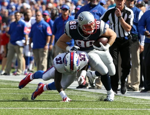 Sep 20, 2015; Orchard Park, NY, USA; Buffalo Bills defensive back Nickell Robey (37) tackles New England Patriots tight end Scott Chandler (88) during the second half at Ralph Wilson Stadium. Patriots defeat the Bills 40 to 32.  Mandatory Credit: Timothy T. Ludwig-USA TODAY Sports