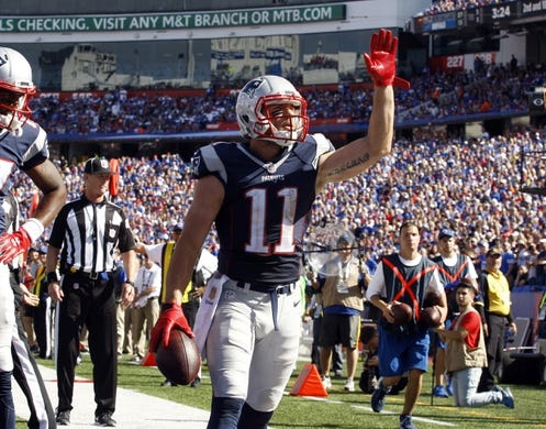Sep 20, 2015; Orchard Park, NY, USA; New England Patriots wide receiver Julian Edelman (11) celebrates his touchdown during the second half against the Buffalo Bills at Ralph Wilson Stadium. Patriots defeat the Bills 40 to 32.  Mandatory Credit: Timothy T. Ludwig-USA TODAY Sports
