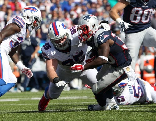 Sep 20, 2015; Orchard Park, NY, USA; Buffalo Bills defensive tackle Kyle Williams (95) makes a tackle on New England Patriots running back Dion Lewis (33) during the second half at Ralph Wilson Stadium. Patriots defeat the Bills 40 to 32.  Mandatory Credit: Timothy T. Ludwig-USA TODAY Sports